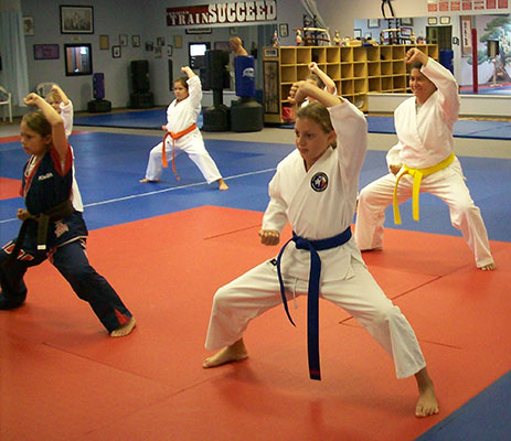 young kids practicing martial arts moves