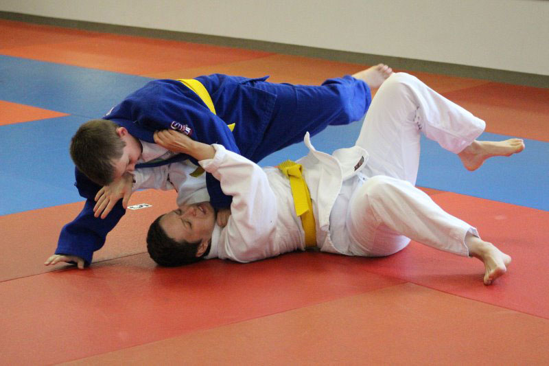 teen martial arts students training